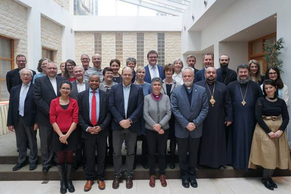 CEC Governing Board stands with staff in group shot in November 2018